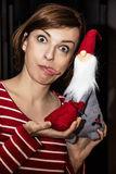Crazy young woman posing with Santa Claus, Christmas scene Royalty Free Stock Photography