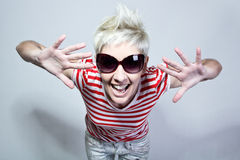 Crazy young woman with sunglasses. Portrait of a crazy young woman with sunglasses Royalty Free Stock Images