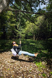 Crazy young woman swing on the rope, hiking theme Stock Photo