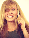Crazy young woman talking on phone Stock Photo