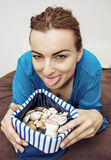 Crazy young woman with various shells in sailor bag Royalty Free Stock Photos