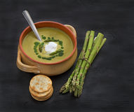 Cream of Asparagus Soup on dark wooden background Royalty Free Stock Photo