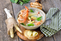 Cream of asparagus soup with prawns Royalty Free Stock Image