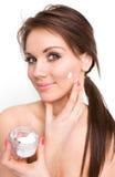 Cream on beauty face Stock Photo