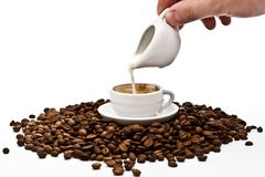 Cream being poured into coffee Stock Images