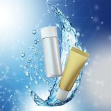 Cream bottle mock up in water splash on blue bokeh background. Stock Images