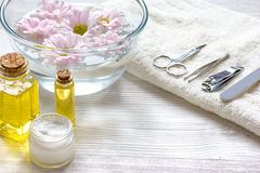 Cream in bowl, oil with manicure set on wooden background.  royalty free stock images