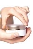 Cream box on the women hand Stock Image