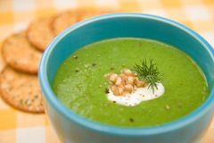 Cream of Broccoli in blue bowl with crackers Stock Images
