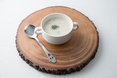 Cream of Broccoli Mushroom Soup. On the wood cut tray Stock Images