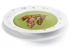 Cream of broccoli soup with bacon. Homemade cream of broccoli soup with bacon and cream Royalty Free Stock Photos