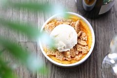 Cream brulee with vanilla ice cream and sesame in caramel. royalty free stock image