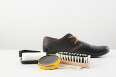 Cream, brush and sponge for care of footwear Royalty Free Stock Photo