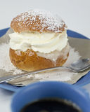 Cream bun with almond paste and coffee Royalty Free Stock Photos