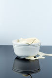 Cream Bursting out of White Bowl royalty free stock images