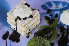 Cream cake. White cream cake on a blue table Royalty Free Stock Photos