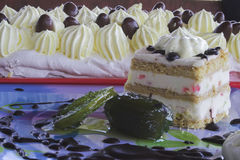 Cream cake. White cream cake on a blue table Royalty Free Stock Photography
