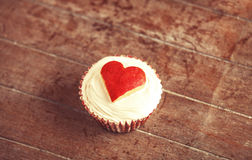 Cream cake with apple heart on it Royalty Free Stock Photo