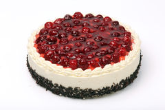 Cream cake with cherries on white background Royalty Free Stock Photo