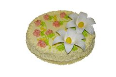 Delicious cream cake decorated with lilies of mastic royalty free stock image