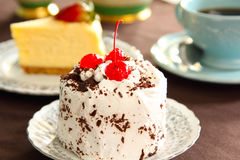 Cream Cake Decorated With Chocolate Flake & Cherry Stock Image
