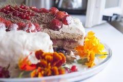 Cream cake, flowers and berries Stock Photos