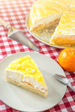 Cream cake with fruit on white plate in kitchen, mandarin cake, product photography for patisserie or restaurant Stock Image