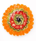 Cream cake with fruits on white background Stock Images