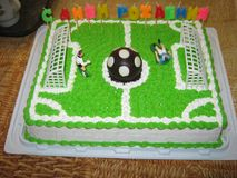 Cream cake guy football player on his birthday with a ball and gate sweets dessert Royalty Free Stock Photo