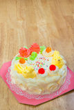 Cream cake with Jelly on the wooden table Royalty Free Stock Images