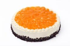 Cream cake with mandarins on white background Royalty Free Stock Image