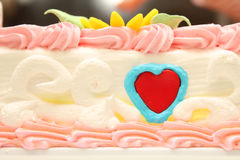 Cream cake with a pattern in the form of heart. Gift for Valentine's Day. Royalty Free Stock Photography