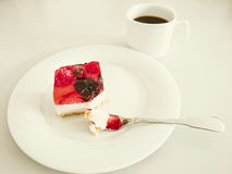 Cream cake with strawberries, raspberries. Blueberries, coffee and fork Royalty Free Stock Photos