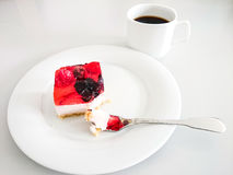 Cream cake with strawberries, raspberries. Blueberries, coffee and fork Stock Image