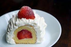 Cream cake with a strawberry slice. Vanilla and cream cake with a strawberry slice on top Stock Photos
