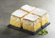 Cream cake slices. Traditional Slovenian dessert - slice of cream cake called Kremna Rezina or Kremsnita.Bled lake,Slovenia,Europe - Image royalty free stock images