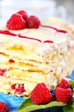 Cream cake with white chocolate and raspberries. Royalty Free Stock Photography
