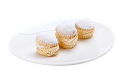 Cream cakes on a plate Stock Image