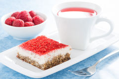 Cream cakes with raspberry and fruit tea Royalty Free Stock Photo