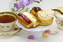 Cream cakes at tea time. Royalty Free Stock Images