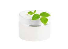 Cream can and green leaf Stock Images