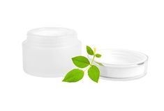 Cream can and green leaf Royalty Free Stock Photo
