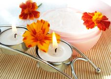 Cream and candle with flowers stock photos