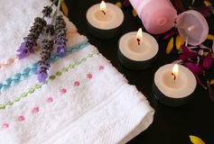 Cream and Candles. Hand Towel with candles and handcream and fresh flowers Stock Photo