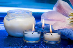 Cream, candles with flower Stock Photography