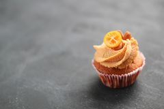 Cream caramel cupcake on black board decorated by almonds Royalty Free Stock Images