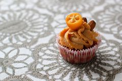 Cream caramel cupcake decorated by almonds Royalty Free Stock Photos