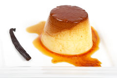 Cream caramel dessert. Vanilla cream caramel dessert on white dish. Shallow depth of field Stock Photo