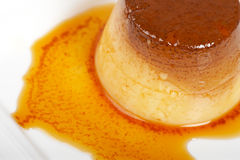 Cream caramel dessert. Vanilla cream caramel dessert on white dish. Shallow depth of field Royalty Free Stock Image