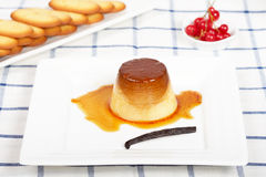 Cream caramel dessert and cookies Stock Image